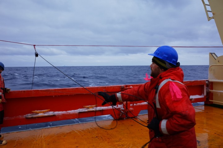 Mike Novak pulling the radiometer back to the surface Photo credit: Isabella Rosso