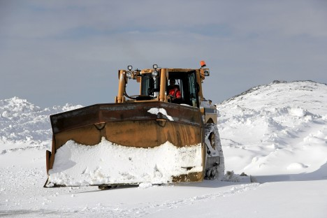 A snow plow removes snow from the second storm of the week at the Kulusuk airport . (credit: Clément Miège.)