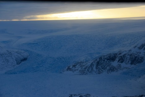 Approaching the ice sheet's edge with the B-212 helicopter. (Credit: Clement Miège.)