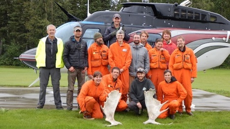 The USFS Forest Inventory & Analysis (FIA) crew before departing Delta Junction by helicopter to sample a remote field plot. Front Row: Katie Rigby, Misha Yatskov, Dan Irvine, Ashley Lehman; 2nd Row: Ken Winterberger, Chad Oukrop, Eric Straley, Seth Ayotte, Brendt Mueller, Michelle Hansen, Warren Childe, Ray Koleser; and 3rd Row: Pilot Josh Toal, Matt O'Driscoll, Warren Childe.