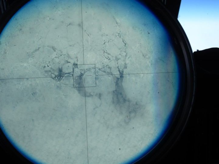 Sea ice, as seen through the ER-2's viewsight, on the 150 degree latitude line north of Alaska. (Credit: Tim Williams/NASA)