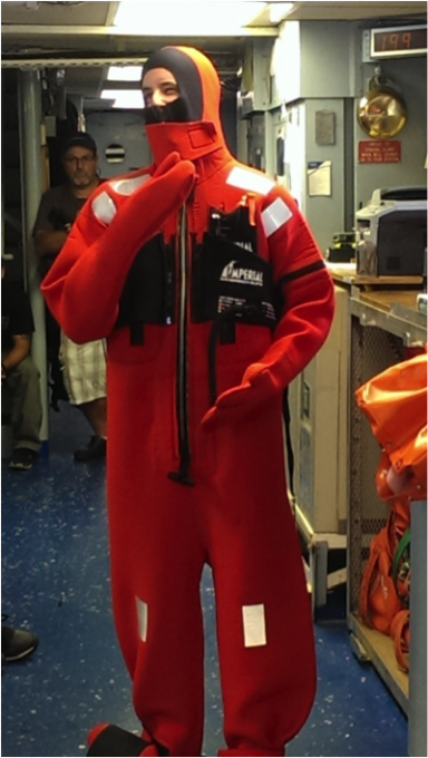 "I'm trying on the immersion suit for the first time and posing ""mannequin-style"" for the safety briefing Friday morning. Photo courtesy of Ivona Cetinic, University of Maine"