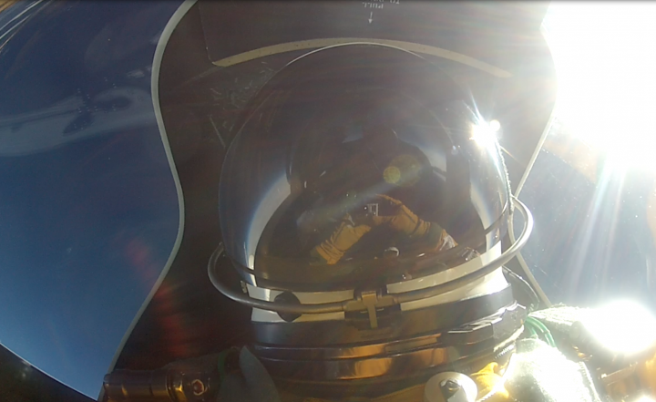 Denis Steele sets up a video camera in the cockpit of the ER-2, 65,000 feet over Alaska's southern mountains.
