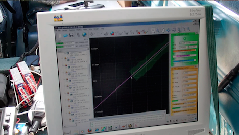 G-LiHT flight computer during data acquisition. The swath of lidar data appears green, the flight line pink, and real-time information on ranging distance and laser returns.