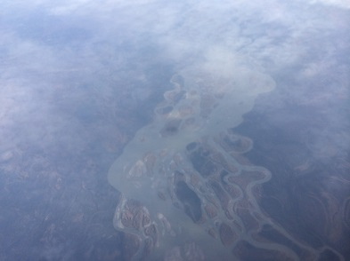 A view of the ground through clouds