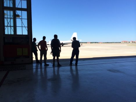 Members of the instrument teams wait for the WB-57 to taxi back to the hangar after the third science flight over Hurricane Gonzalo.