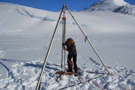 Olivia retrieving the piezometer at our training site on a frozen lake near Kulusuk in the spring.