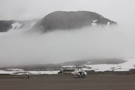 Fog rolled in over the airport with the helicopter we'll be using in the background.