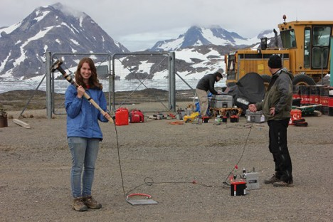 Lynn, Nick, and Anatoly testing out the seismic gear at the airport.