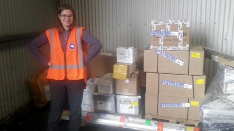 Christine stands near to our instruments and equipment, ready to be shipped to Antarctica.