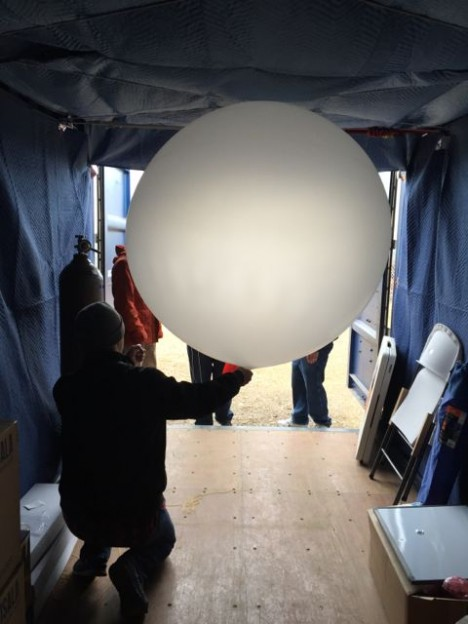 The balloon is inflated with helium in another one of NPOL's trailers, after which the instrument is attached and we head outside to launch the sounding. (Photo credit: Dr. Angela Rowe, UW)