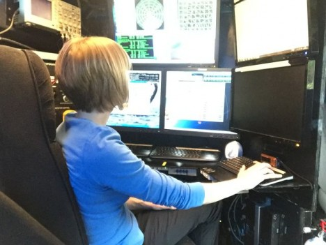Dr. Angela Rowe monitoring data inside the DOW truck.