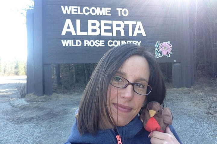As Chirpy and I were posing in front of the Welcome to Alberta sign, some people in a car stopped and said they thought he was a real bird! Photo credit: Natalie Boelman.