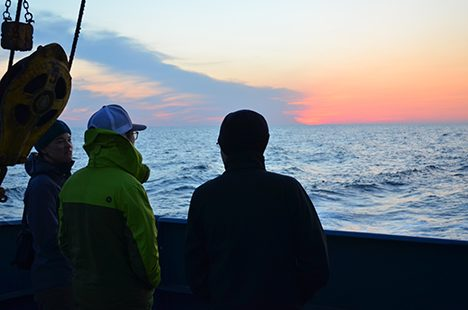 NAAMES-II Scientist enjoying the sunset on the aft deck of the RV Atlantis. Photo: Jack Porter