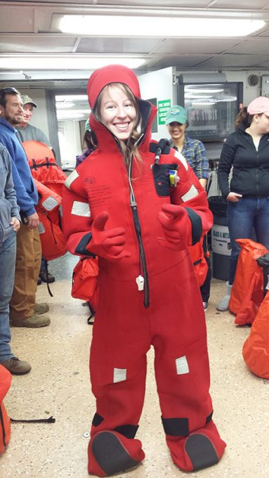 Kelsey McBeain, a master's student from the lab of Kim Halsey, dons the survival suit during the safety drills. Photo: Kristina Mojica