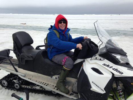 Walt Meier on a snowmobile.