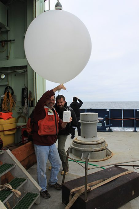 A weather balloon is filled with helium and the radiosonde is attached. Photo: Jim Johnson