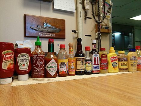 Condiments in a line.