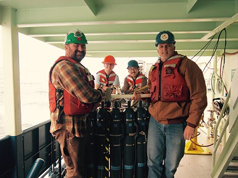 Representatives from UCSB's ocean optics and microbial oceanography groups. Front, left to right: Stuart Halewood, Associate Development Engineer, and Craig Carlson. Back, left to right: James Allen and Nick Huynh, Graduate Student Researchers.  PC: Pete Gaube