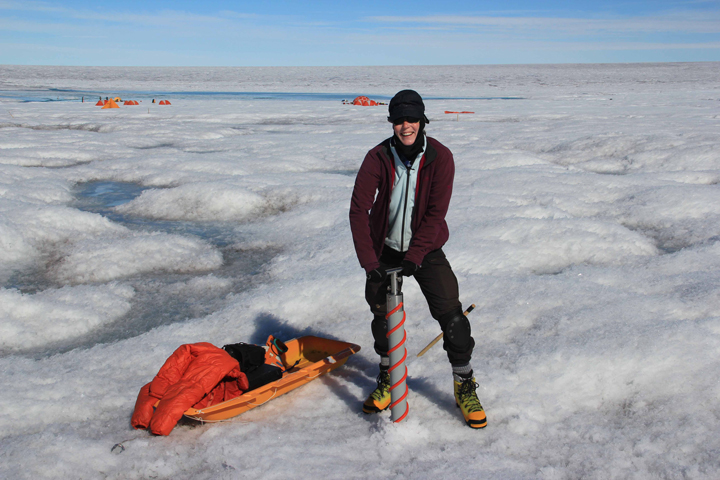 Asa is operating the coring drill from the surface to retrieve ice cores. Photo by Clem Miege.