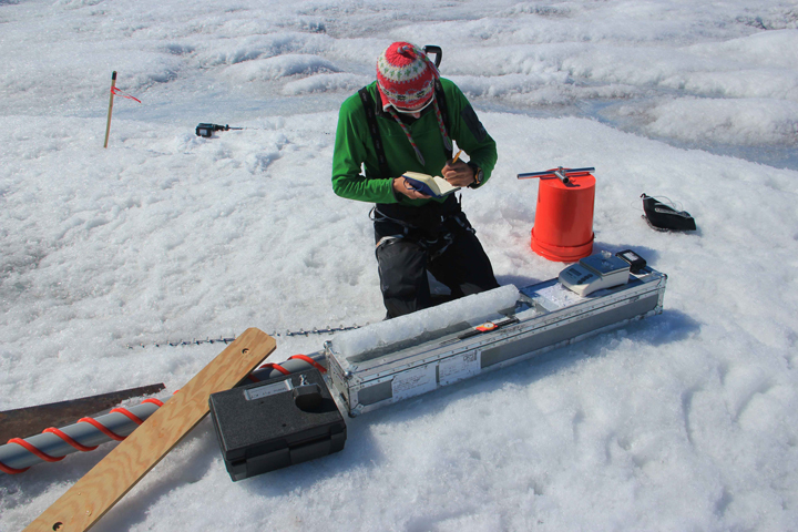Clem is processing the first meter of the ice cores, logging mainly stratigraphy and densities. Photo by Matt Cooper.
