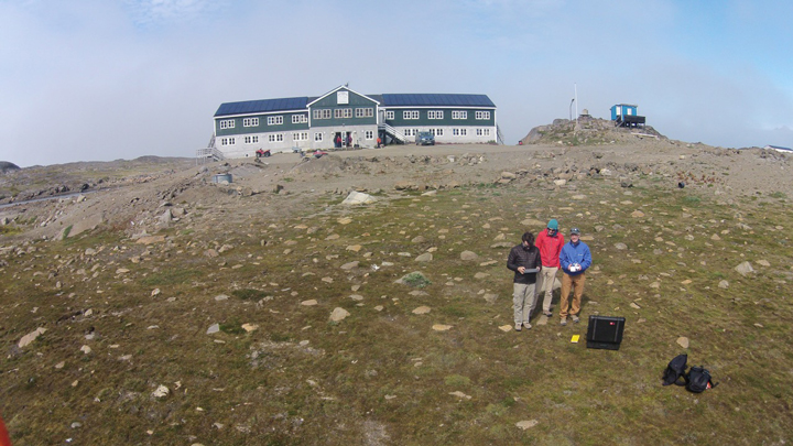 Photo from the drone: Nick, Stefan, and Rick in front of Hotel Kulusuk.