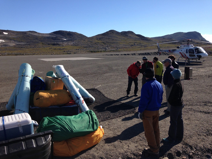 """Packing the first sling load with the BlueWest helicopter on the right."""""""
