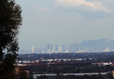 The Los Angeles skyline is hazy with smog generated from air pollutants emitted by cars. The air pollution doesn't stay in the city, however, but will eventually travel to other parts of the world. Credit: Michael Prather