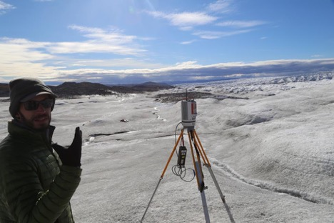 Charlie is testing his Lidar system at the edge of the ice sheet. Credit: Lincoln Pitcher.
