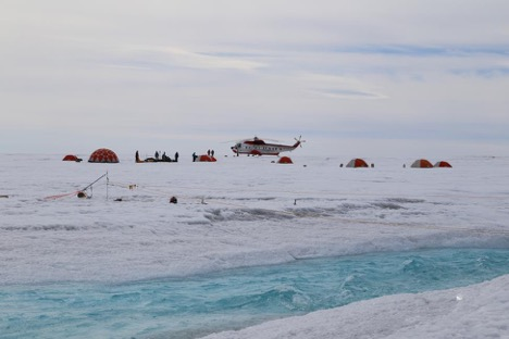 Caption: View of ice camp and helicopter. Photo by Lincoln Pitcher.