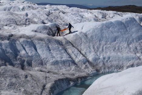 Charlie and Clem are carrying the ground-penetrating radar over the glacier, the surface roughness made it difficult for the radar to operate. Credit: Lincoln Pitcher.