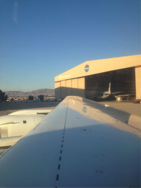 View from the DC8 back to the NASA-Armstrong hangar in Palmdale, California (Credit: Christina Williamson).
