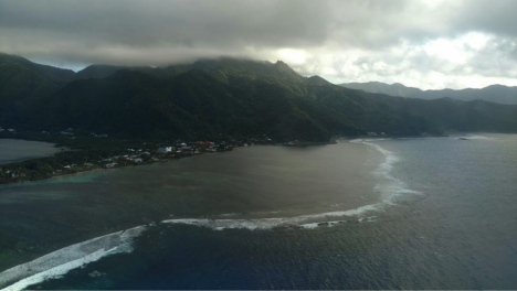 The DC-8 climbs steeply away from the tropical island of American Samoa, with its mountains covered by warm clouds. The next land we see on the ATom mission is the South Island of New Zealand, deep in winter. Credit: Bruce Daube, Harvard University.