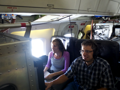 Agnieszka Kupc, NOAA/University of Vienna running our suite of instruments measuring aerosol microphysical properties and Dan Murphy, NOAA, running an instrument looking at the chemical composition of individual aerosol particles during the ATom equator flight. Credit: Christina Williamson