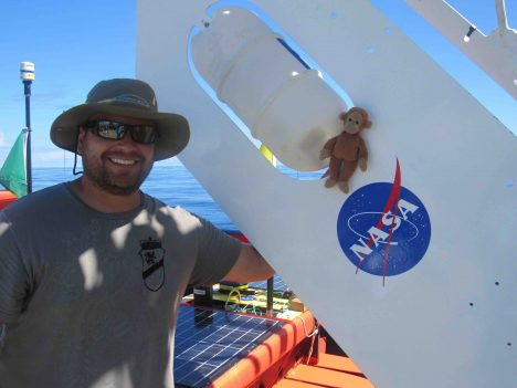 Andrew Meyer and Monkey pose with the SPURS-2 Central Mooring buoy.
