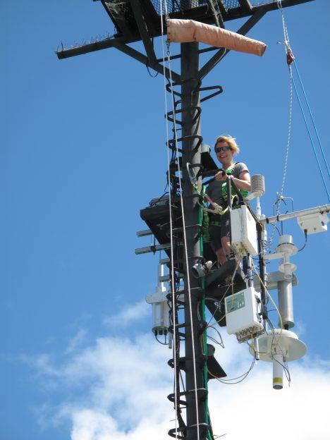 Carol Anne Clayson at work on the bow mast.