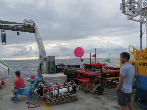 Launching a balloon from the R/V Revellle, for atmospheric sounding.