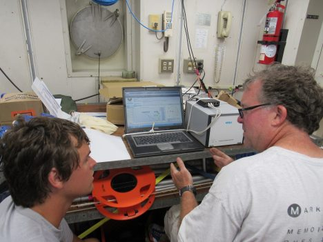 Jim Edson from University of Connecticut and Raymond Graham, a graduate student at U.Conn., looking over the first results from the balloon deployment.