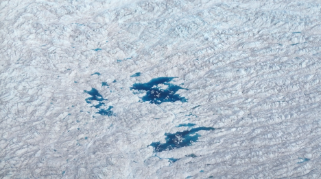 Bright blue melt ponds on the Greenland Ice Sheet. Photos by Róisín Commane