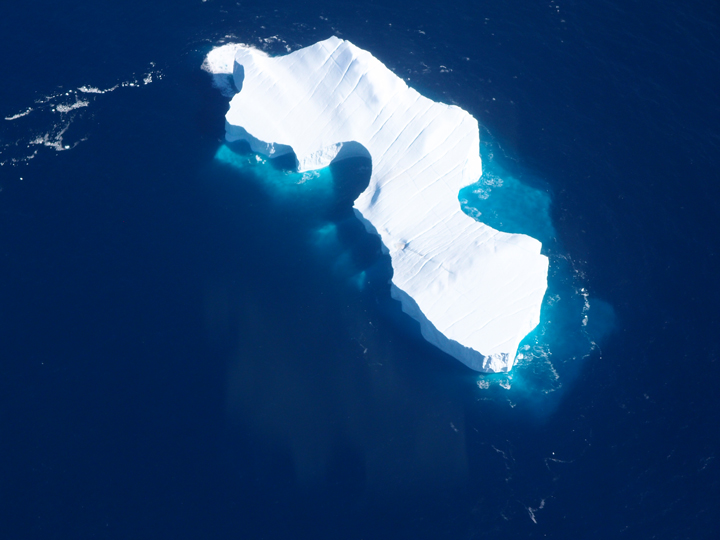 Fantastic view of a huge iceberg; the walls are likely 10-20 meters high. Also note the nice crevasses (the diagonal lines) on the surface.