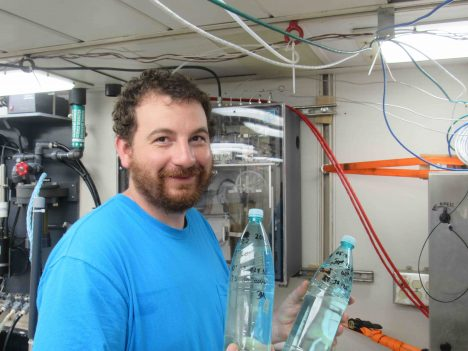 Dan Clark with two of his nearly 50 bottles of samples for investigation of ocean microplastics.