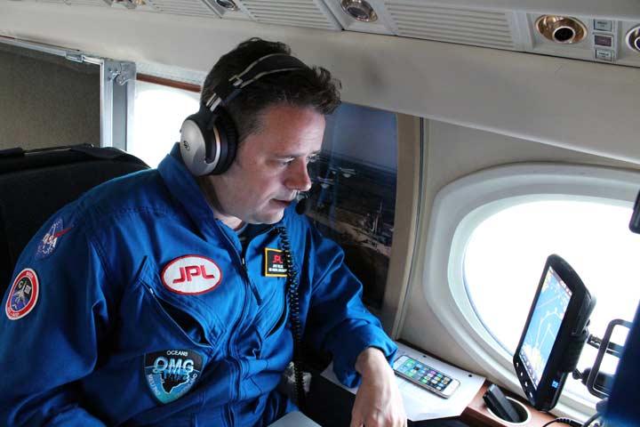 Lead scientist Josh Willis prepares to mark the probe drop on his GARMIN GPS.