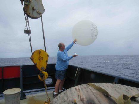 Kelsey's balloon, floating away.