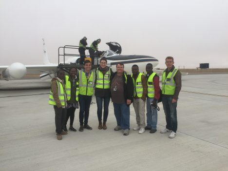 "Namibian interns in front of the ER-2 aircraft, checking out our instrument: ""AirMSPI"". Credit: Walvis Bay airport employees."