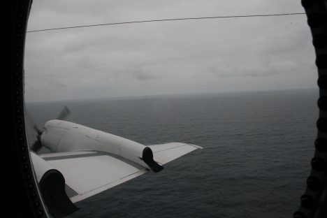 View of the marine boundary layer with stratocumulus clouds above and the Atlantic Ocean below from outside the P3 window. Photo credit: Michael Diamond