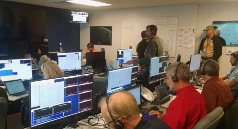 The MOC team hard at work pouring over initial engineering data from the spacecraft on December 16, 2016. Photo credit: Chris Ruf