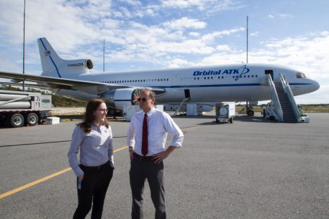Prof. Ruf and I chat with the L-1011 aircraft and Pegasus XL rocket in the background. Photo credit: Aaron Ridley